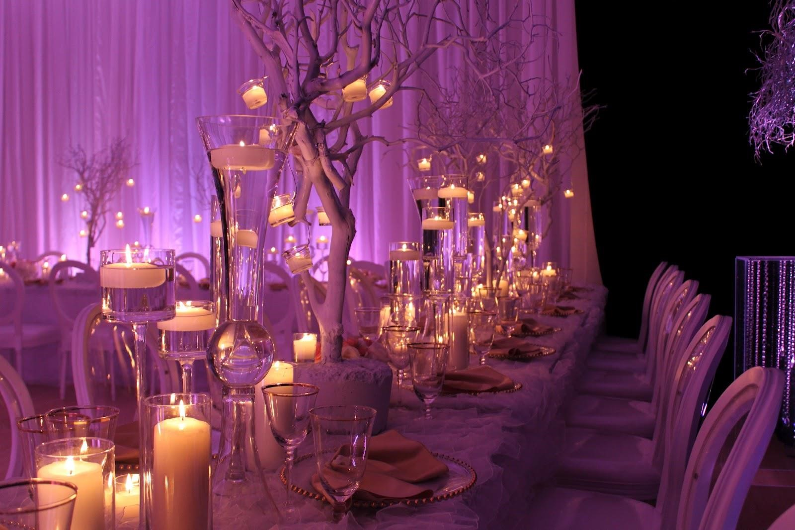 Decor themes white gold with a splash of purple for Wedding party centerpieces